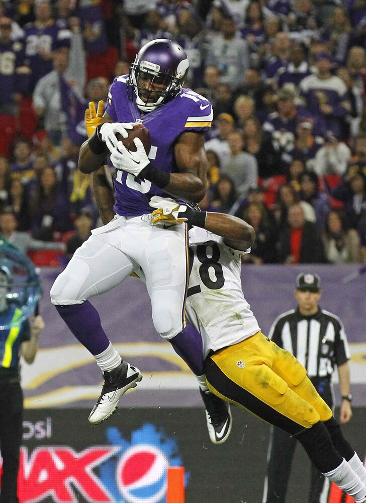 Minnesota Vikings wide receiver Greg Jennings catches a touchdown pass against Pittsburgh Steelers cornerback Cortez Allen during the Vikings 34-27 win at Wembley Stadium, London, on Sunday. (Sang Tan / The Associated Press)