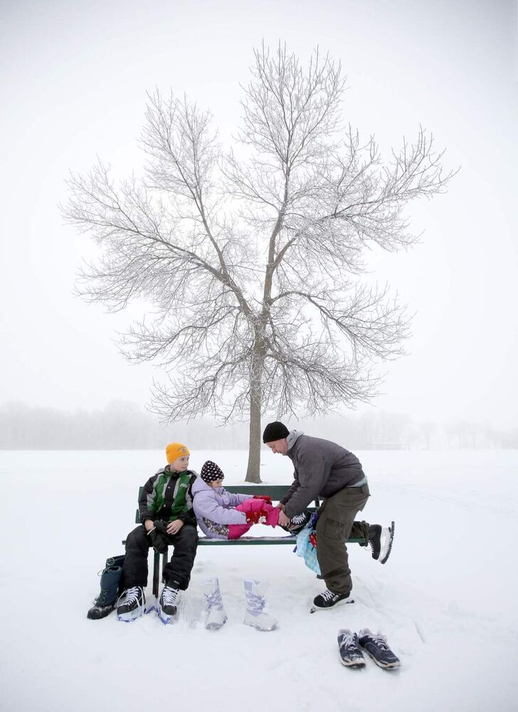 Frost smitten - I photograph a lot of moments people just want to forget, things we don't always want to see. I've picked this as my favourite image - Jim Craig with his children Larianne and Joshua at St. Vital Park on a frosty February day - because it's simply a beautiful moment, a moment universal in its appeal. Every kid has a memory like this from their childhood... something we all want to remember and do.  (Phil Hossack/Winnipeg Free Press)