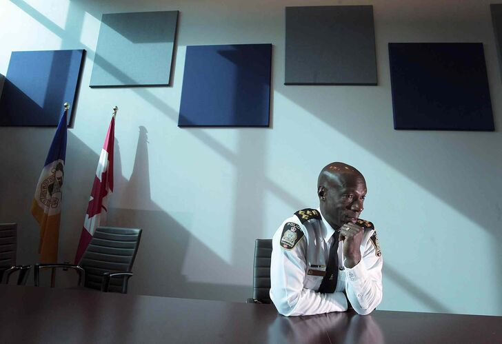 Winnipeg Police Chief Devon Clunis crunches the numbers from the perspective of his new headquarters boardroom. -