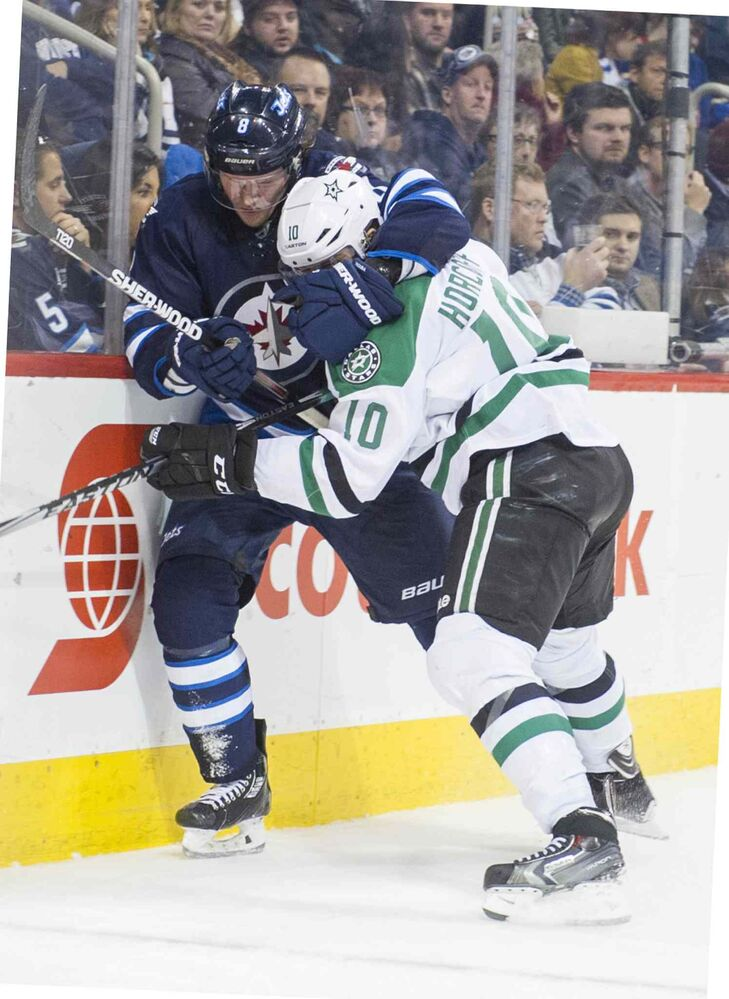 Winnipeg Jets Jacob Trouba (#8) grapples with Dallas Stars Shawn Horcoff (#10) during the third period of Saturday's game. (DAVID LIPNOWSKI / WINNIPEG FREE PRESS)