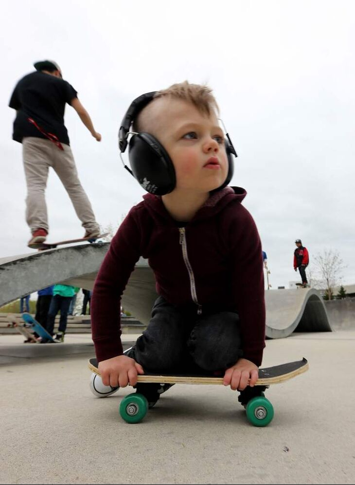 Cruz Friesen, 2, works on some moves while protecting his ears. (TREVOR HAGAN / WINNIPEG FREE PRESS)