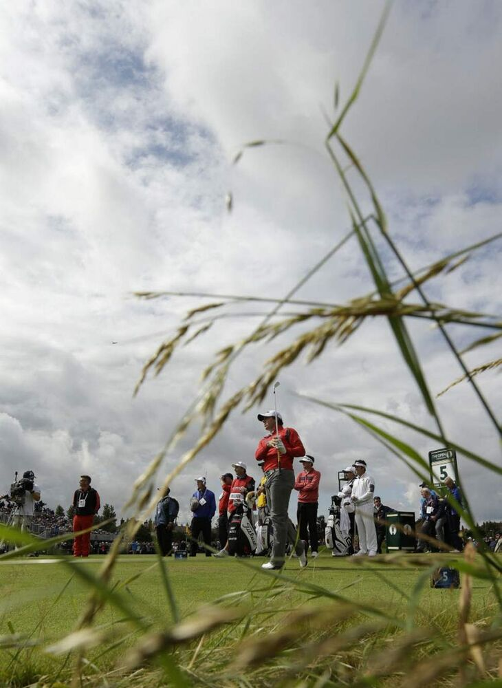 Rory McIlroy of Northern Ireland watches his shot off the fifth tee at Royal Lytham & St Annes golf club during the second round of the British Open Golf Championship, Lytham St Annes, England. (AP Photo/Jon Super)