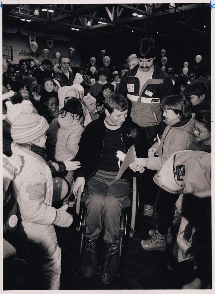 Rick Hansen is surrounded by schoolchildren as he takes his Man in Motion tour to the University of Manitoba where he was the star of a pep rally. A crowd of more than 3,000 people greeted him with a tumultuous five-minute ovation. Wayne Glowacki / Winnipeg Free Press Archives January 20, 1987