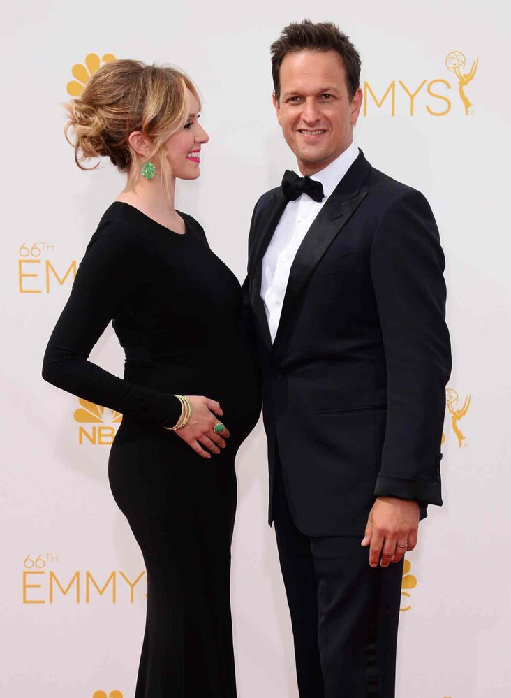 Sophie Flack, left, and Josh Charles (The Good Wife) arrive at the 66th Annual Primetime Emmy Awards at the Nokia Theatre L.A. Live Monday in Los Angeles.  (Jordan Strauss/Invision/ The Associated Press)