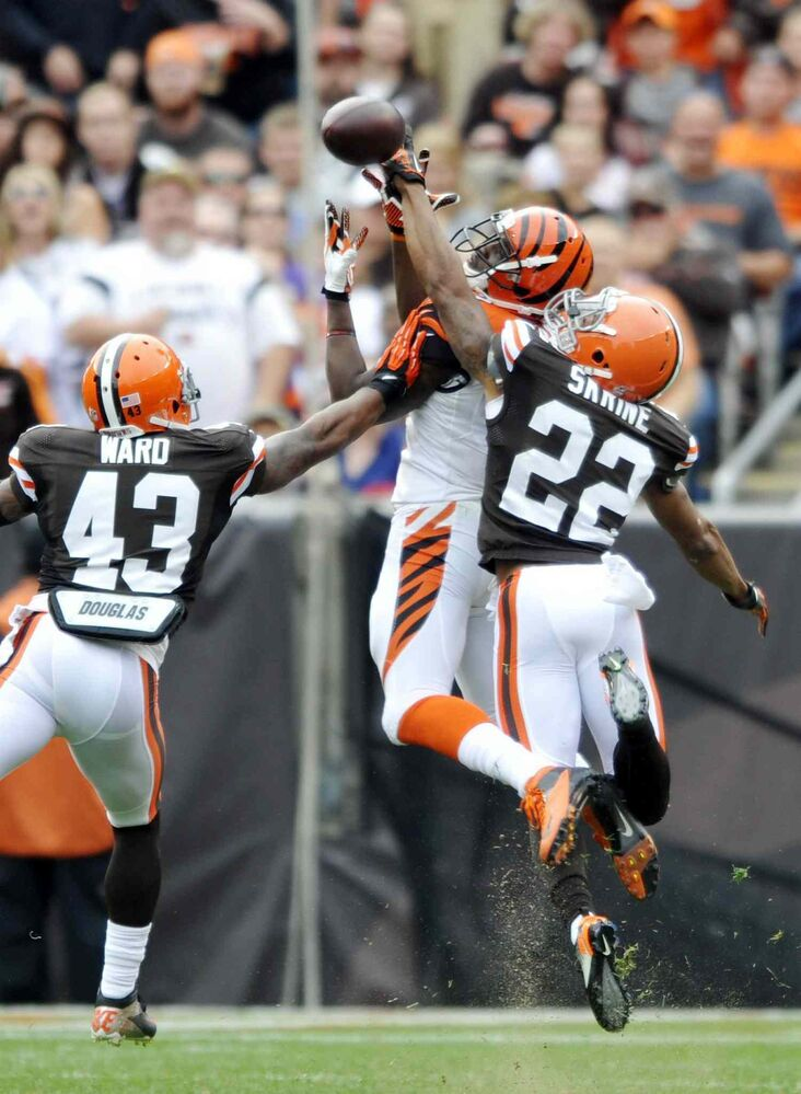Cleveland Browns cornerback Buster Skrine (right) knocks away a pass from Cincinnati Bengals wide receiver Mohamed Sanu (middle) as strong safety T.J. Ward helps out in the second quarter the Browns' 17-6 win Sunday, in Cleveland.  (David Richard / The Associated Press)