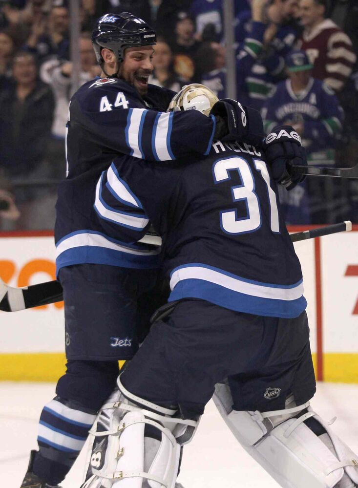 Winnipeg Jets' Zach Bogosian celebrates win over the Vancouver Canucks with goaltender Ondrej Pavelec after the Jets beat the Canucks 4-3 Friday night. (JOE BRYKSA / WINNIPEG FREE PRESS)