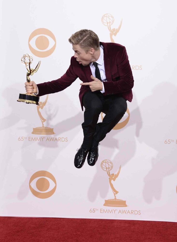 Derek Hough poses with the award for outstanding choreography for his work on Dancing with the Stars. (Dan Steinberg / The Associated Press)