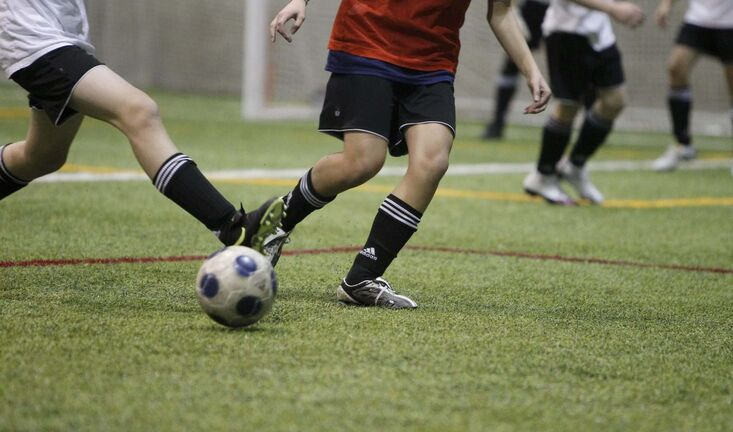 TREVOR HAGAN / WINNIPEG FREE PRESS - Members of a girls under 15 team, and boys under 14 team, face off at the Winnipeg Soccer Federation Indoor Soccer Complex near the University of Manitoba. 10-03-10</p>