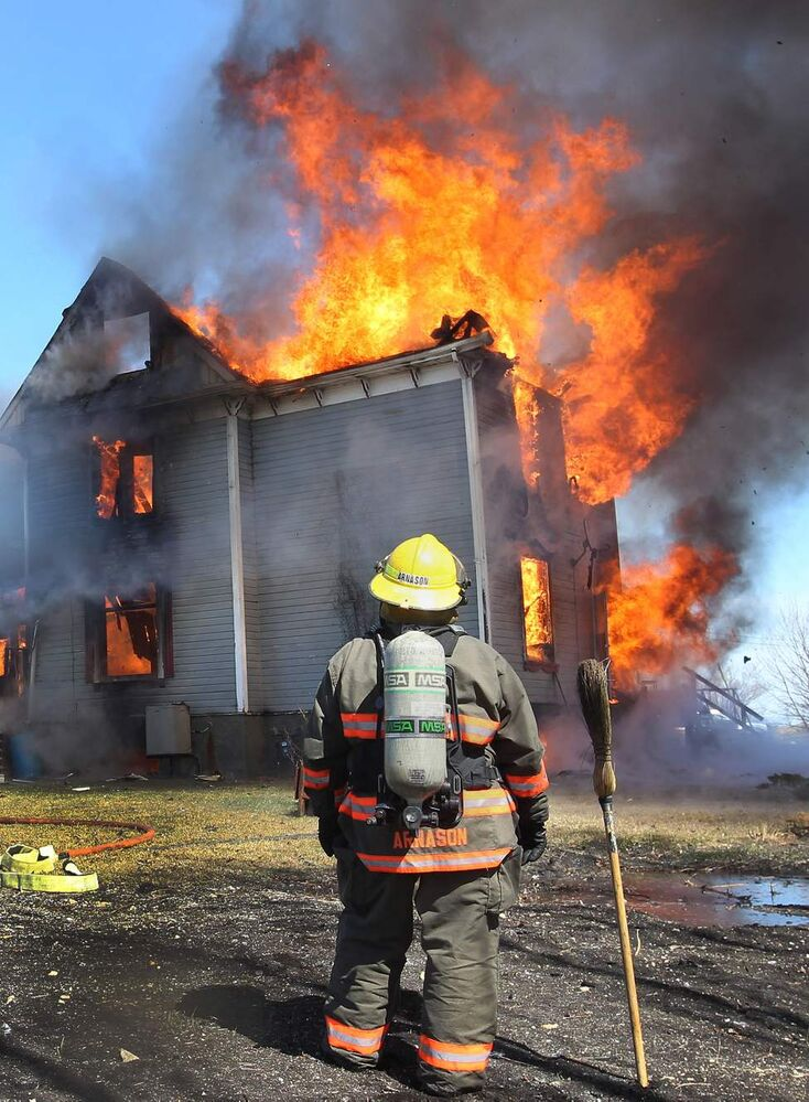 A firefighter who arrived as backup could only watch as flames engulfed a home to a total loss on Kapeulus Drive in West St. Paul.