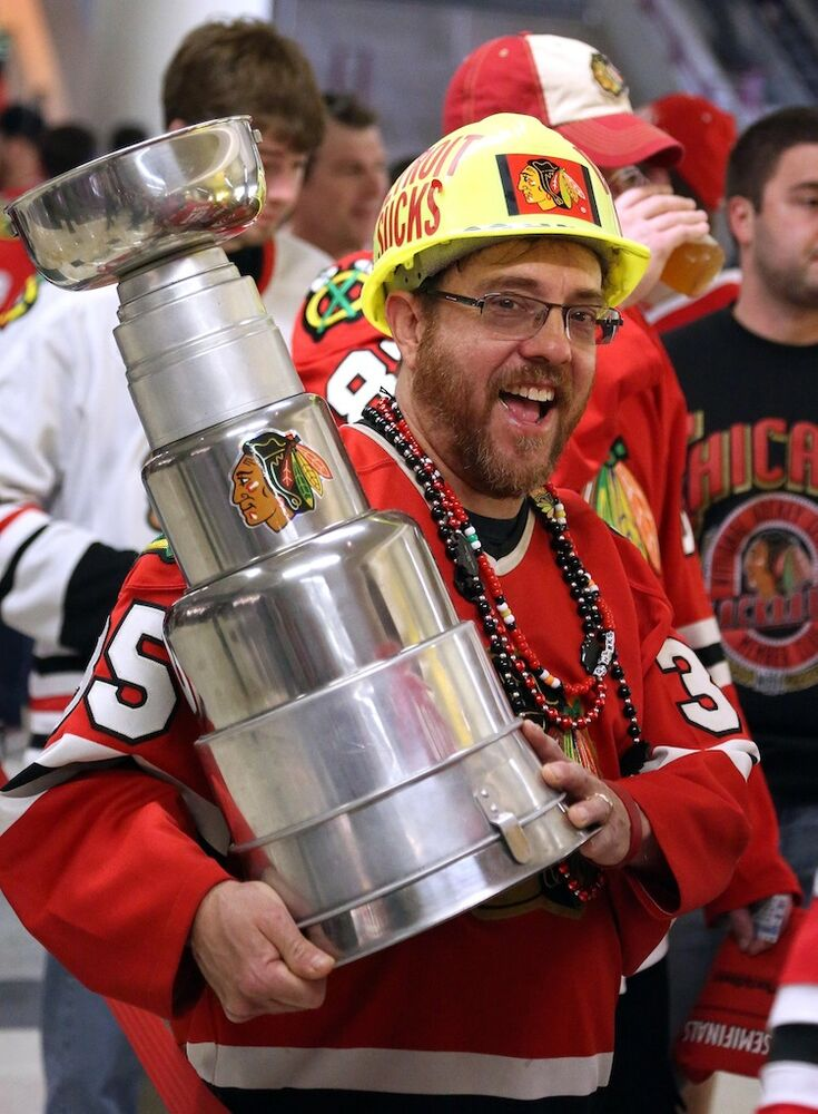 Ray Alcala, of Lisle, Ill. celebrates with his homemade Stanley Cup after the Blackhawks defeated the Detroit Red Wings 2-1 in overtime in Game 7 of the NHL hockey Stanley Cup Western Conference semifinals Wednesday.