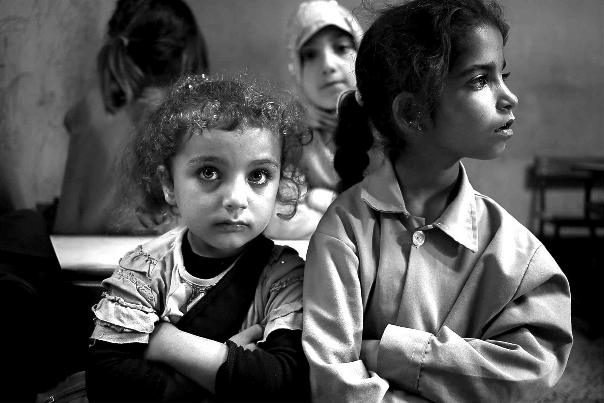 Syrian refugee students sit in their classroom  at a Lebanese public school.