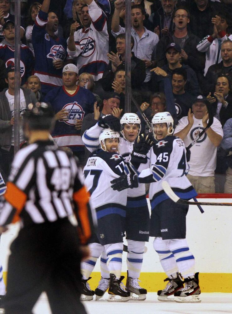 Left to right #77 Kevin Clark, #49 Ben Maxwell and Mark Scheifele celebrate the teams second unanswered goal Tuesday against Columbus in their first home game in 15 years.
