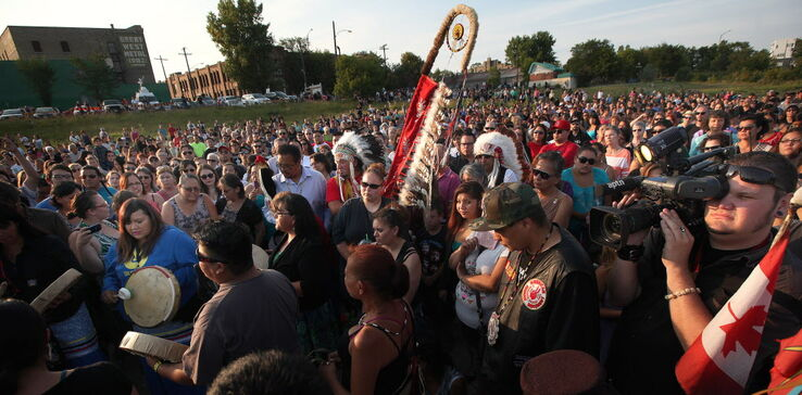 Elders, activists, citizens and family gather for a vigil at the Alexander Docks Tuesday in memory of Faron Hall and Tina Fontaine, whose bodies were pulled from the Red River Sunday.