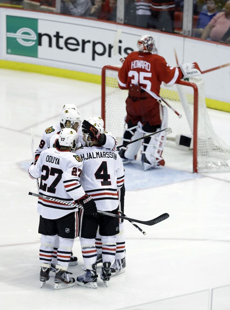 Chicago Blackhawks center Michal Handzus celebrates his penalty-shot goal with teammates.