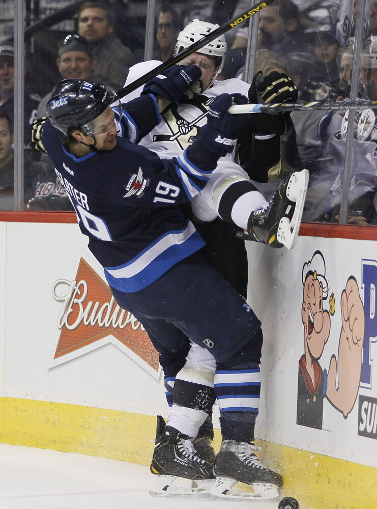 Winnipeg Jets' Jim Slater (19) checks Pittsburgh Penguins' Paul Martin (7) during the second period. (John Woods / The Canadian Press )