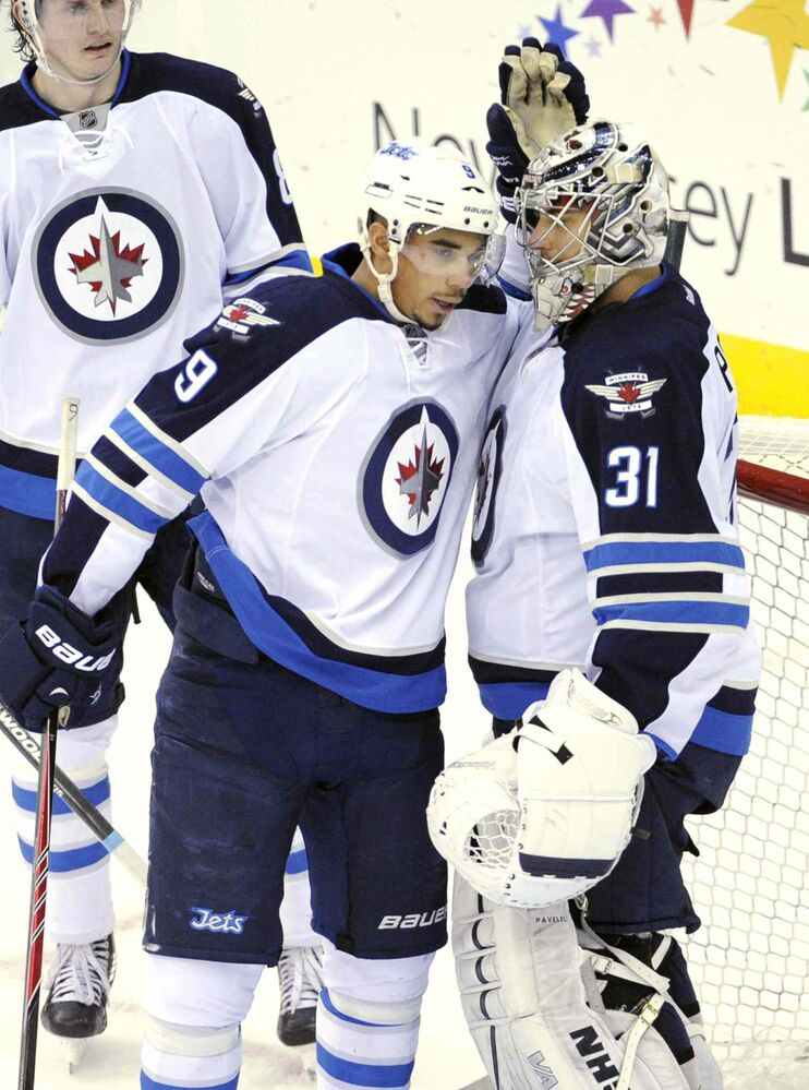 Winnipeg Jets goaltender Ondrej Pavelec celebrates with teammate Evander Kane after the Jets defeated the New Jersey Devils 3-1in Newark, N.J., Monday. (BILL KOSTROUN / THE ASSOCIATED PRESS)