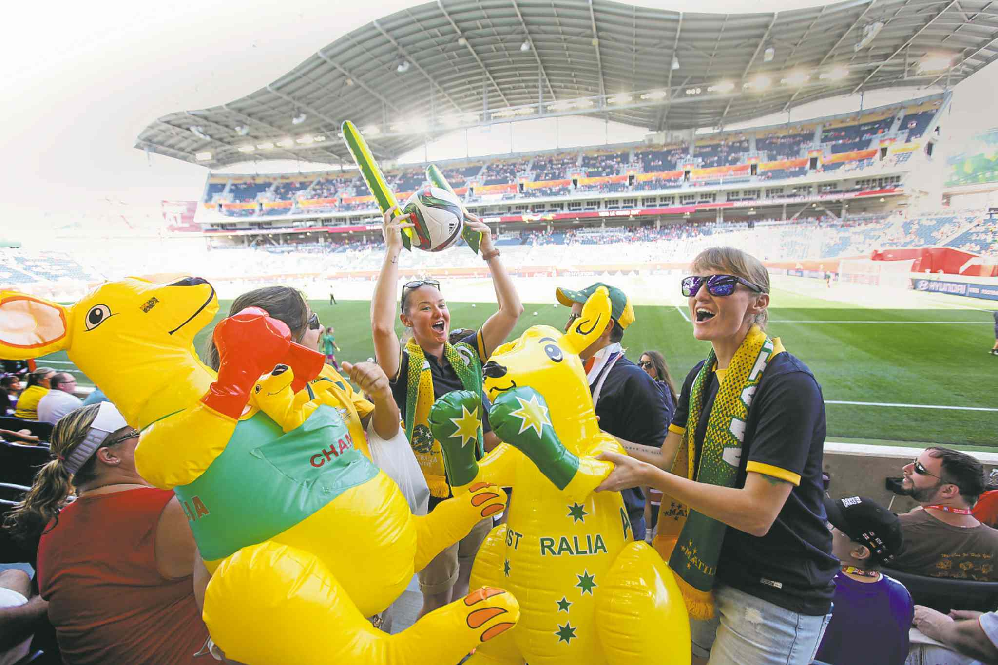 A large group of  Aussies prepares to cheer on Australia in one of seven FIFA Women's World Cup matches hosted at Investors Group Field in June.