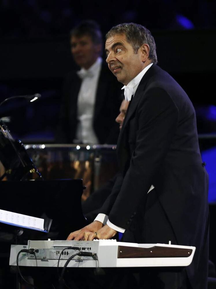 Actor Rowan Atkinson performs during the Opening Ceremony at the 2012 Summer Olympics, Friday, July 27, 2012, in London.