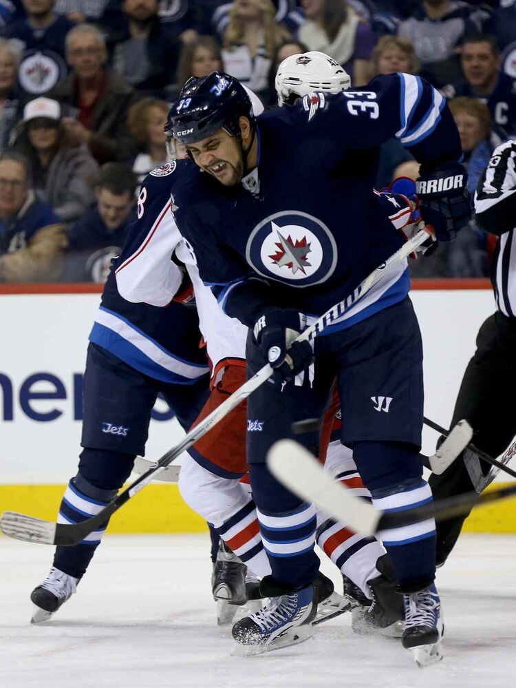 Winnipeg Jets' Dustin Byfuglien (33) tries to get out of the way of a point shot during the second period.  (Trevor Hagan / Winnipeg Free Press)