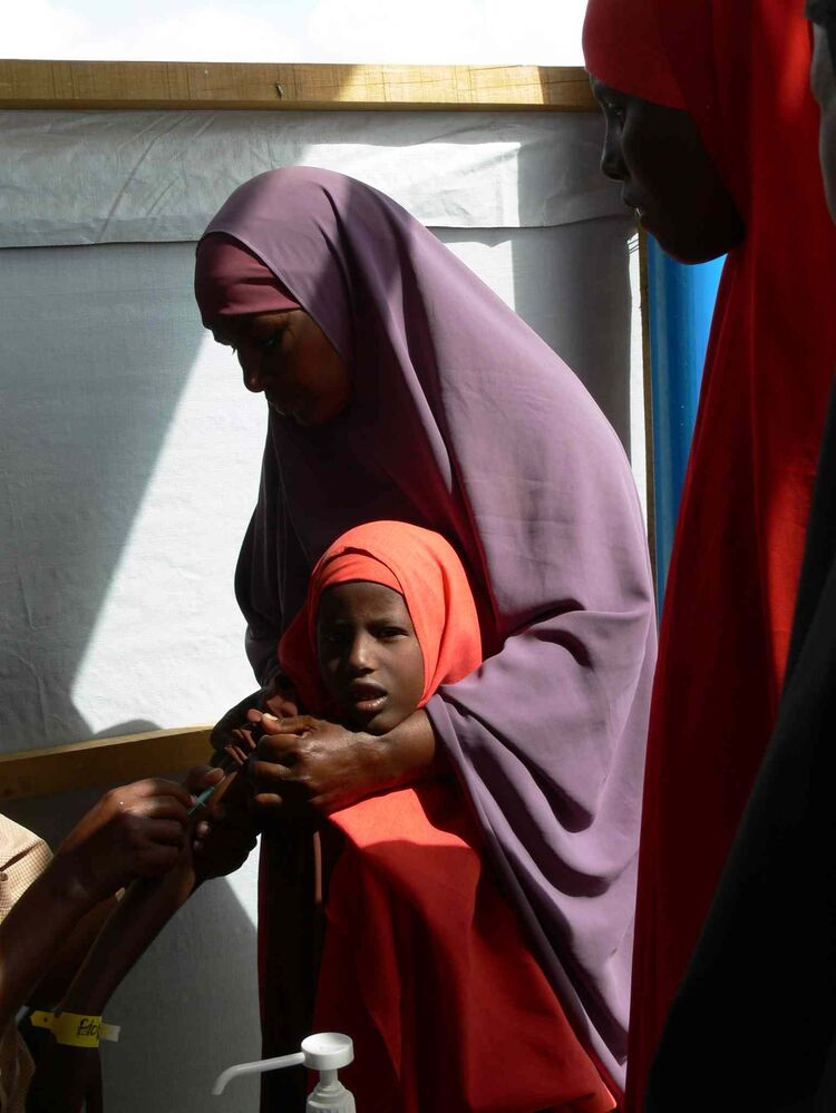 Children are immunized as one of the first steps in the registration process for refugees. Over two days in late May, more than 800 new refugees were registered at the UNHCR registration centre at Ifo 2 camp in Dadaab. (Carol Sanders / Winnipeg Free Press)