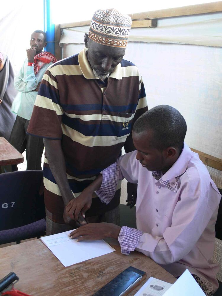 Refugees registering at Ifo 2 camp in Dadaab are finger printed the old-fashioned way during security screening. The Kenyan government  requires the finger prints for security reasons.  (Carol Sanders / Winnipeg Free Press)