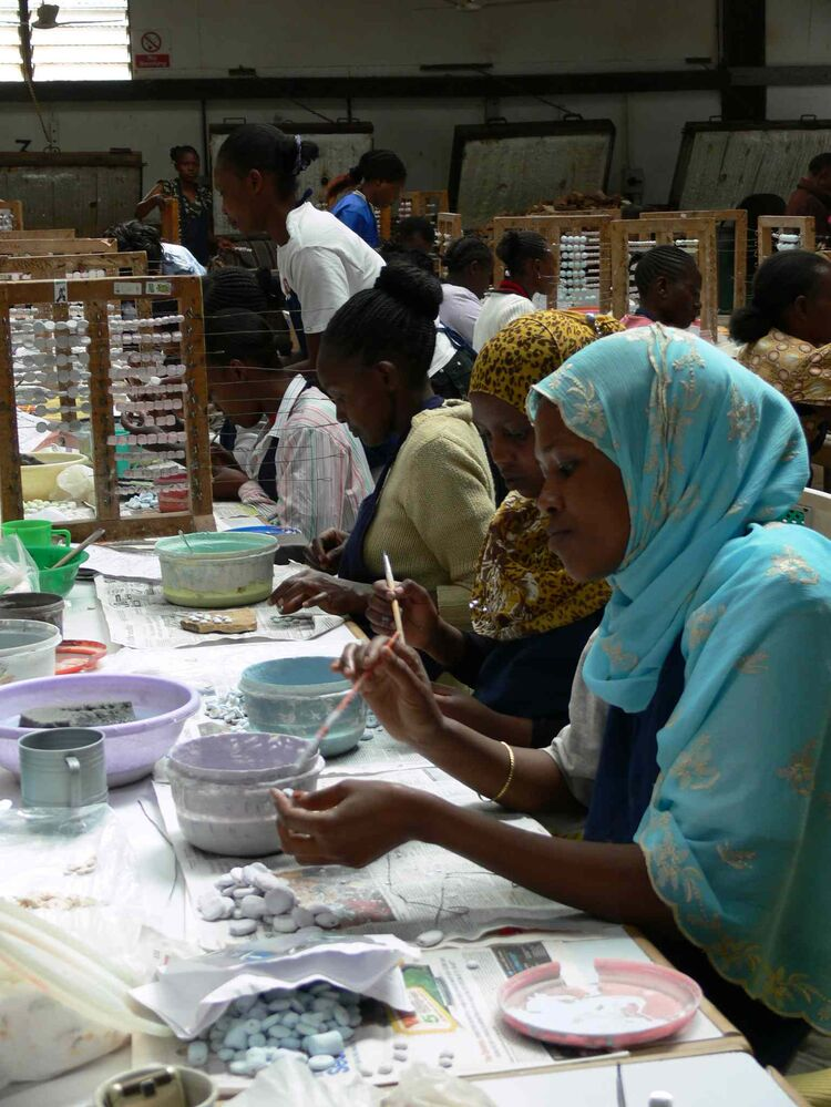 Workers paint ceramics at Kazuri.