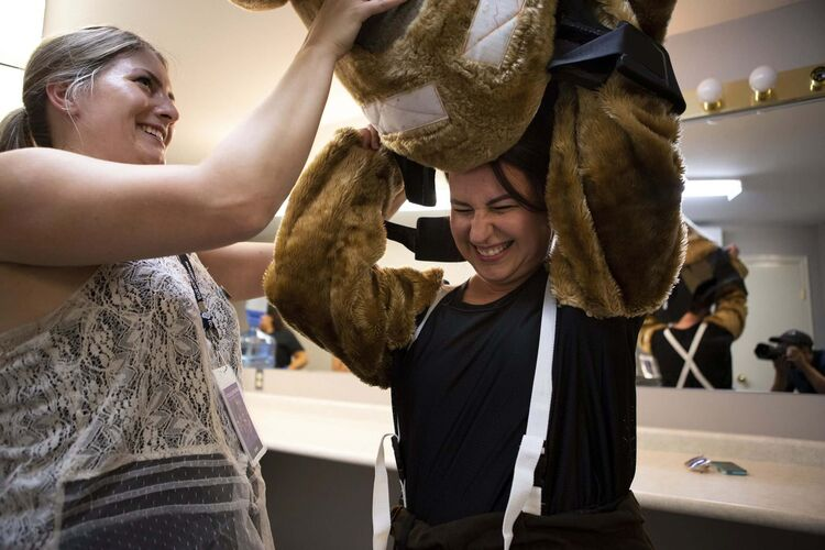 Photos by ANDREW RYAN / WINNIPEG FREE PRESS</p><p>Free Press columnist Jen Zoratti receives some help putting on the Folklorama Llama costume.</p>