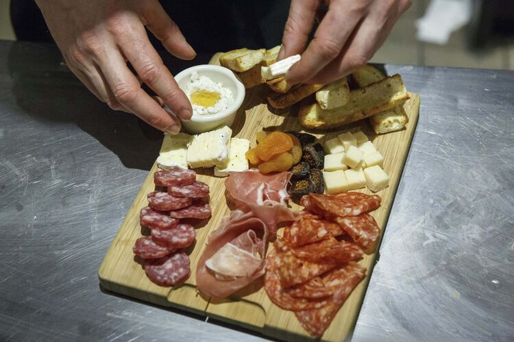 MIKE DEAL / WINNIPEG FREE PRESS</p><p>Preparing a charcuterie board which contains parmesan cheese, brie cheese, calabrese salami, cured salami, herbed ricotta with honey and olive tapenade.</p>