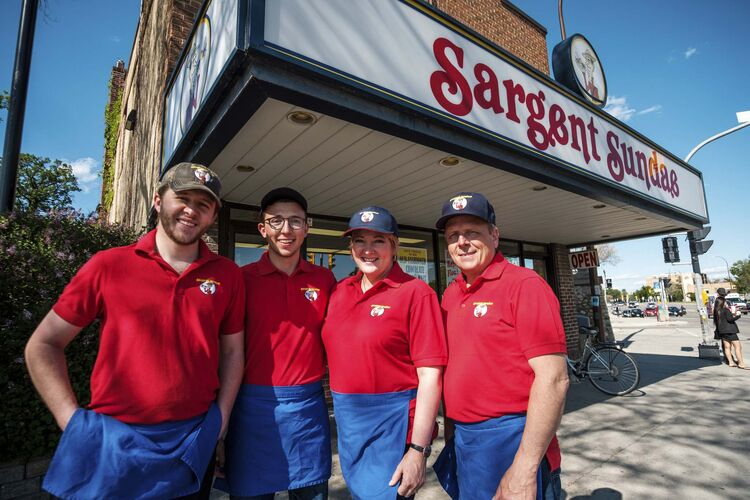 Andrew (left), William, Lynn and John Dusessoy stand in front of the family business at the corner of Portage Avenue and Overdale Street.</p>