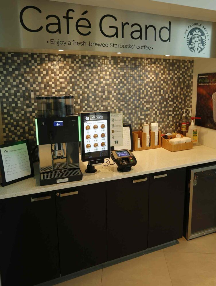 A credit-card-based and automated Starbucks is in the the lobby.