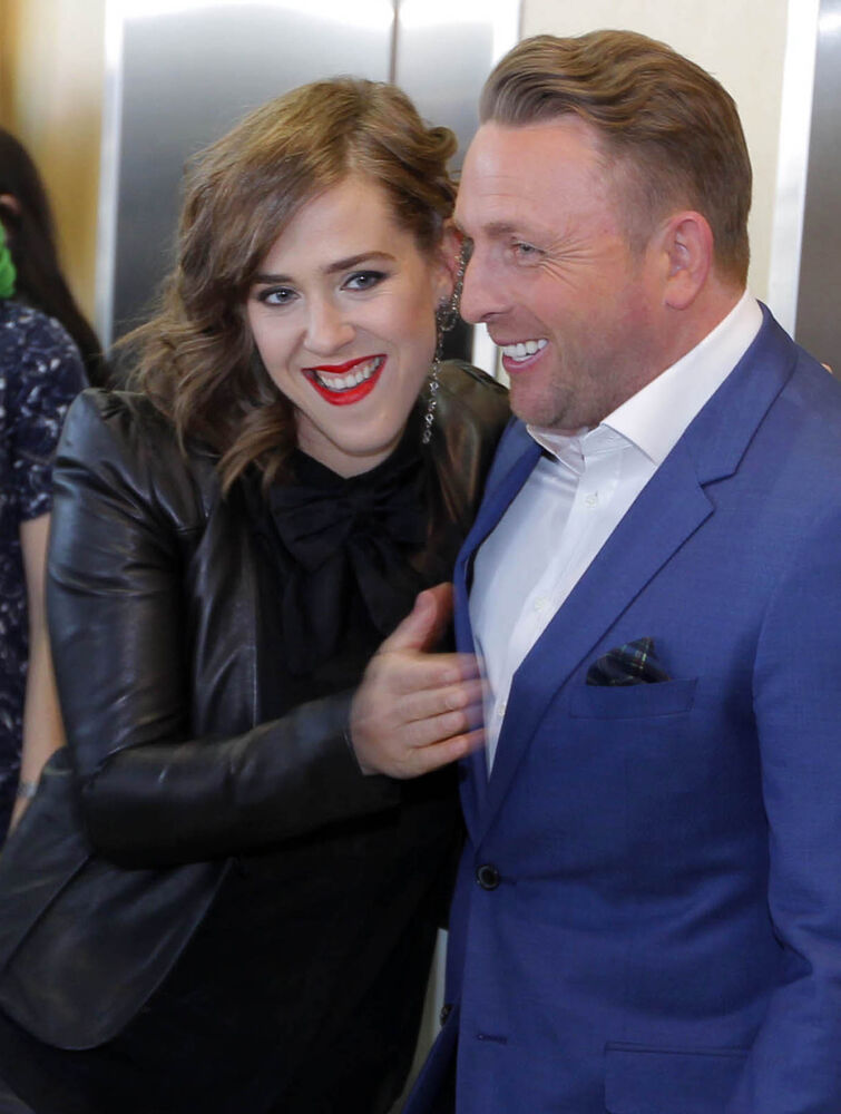 Johnny Reid and Serena Ryder pose during a media event at the MTS Centre Friday.