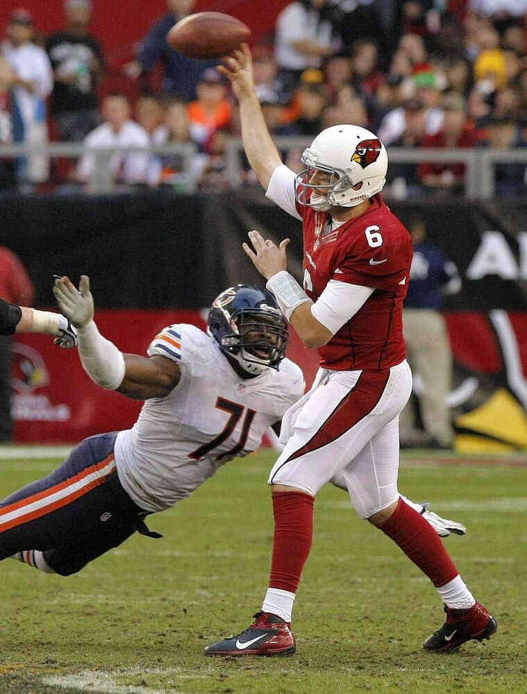 Seen at left tackling Arizona Cardinals quarterback Brian Hoyer during a 2012 NFL game, Israel Idonije (#71) said he hopes the graphic novels will draw kids into reading and help them discover their true gifts.