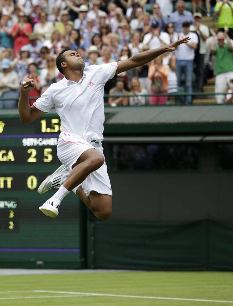Jo-Wilfried Tsonga of France reacts after defeating Lleyton Hewitt of Australia during their first round men's singles match at the All England Lawn Tennis Championships at Wimbledon, England. (AP Photo/Tim Hales)