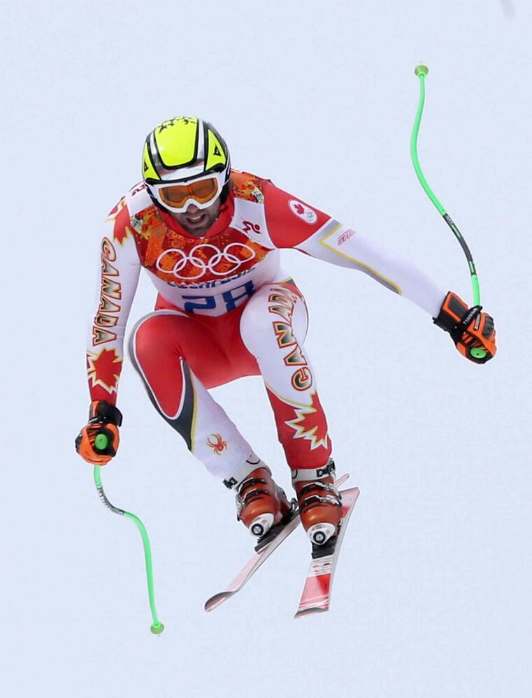 Canada's Manuel Osborne-Paradis jumps during the men's downhill at the Sochi 2014 Winter Olympics, Sunday. (Luca Bruno / The Associated Press)