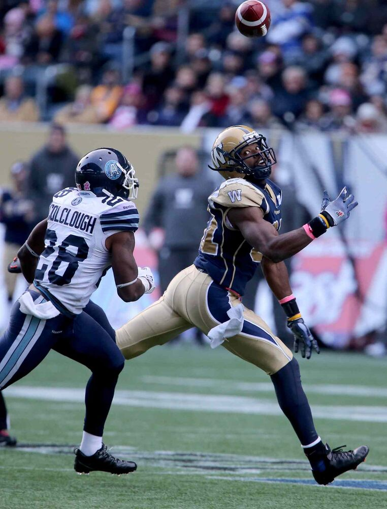 Winnipeg Blue Bombers' Cory Watson (81) has a pass go through his fingers as he's pursued by Toronto Argonauts' Ricardo Colclough (28) during the second half. (TREVOR HAGAN / WINNIPEG FREE PRESS)