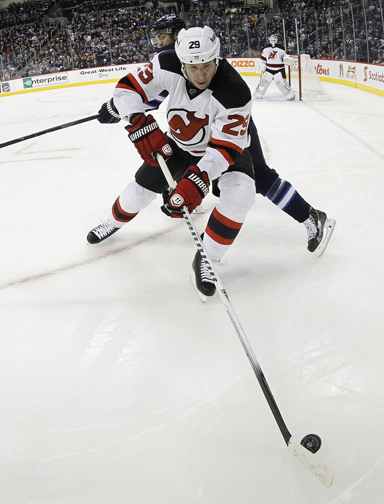 Ryane Clowe and Michael Frolik battle for the puck during the second period. (Trevor Hagan / The Canadian Press)