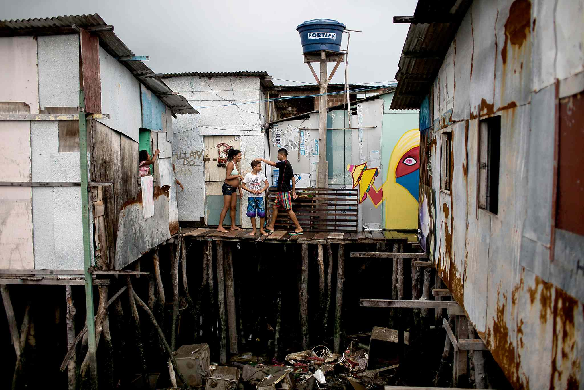 Tainara Lourenco, who's five months pregnant, at her stilt home built over polluted water in a slum in Recife, Brazil.
