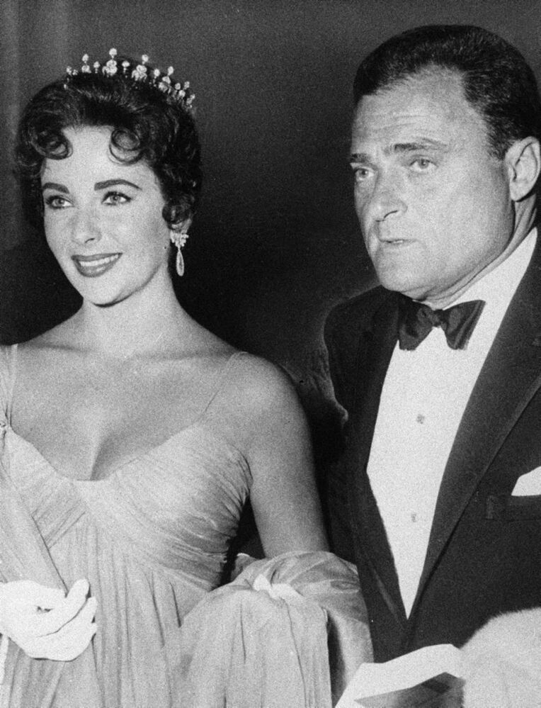 In this 1957 file photo, actress Elizabeth Taylor is shown with her husband Mike Todd.  (AP Photo/File)