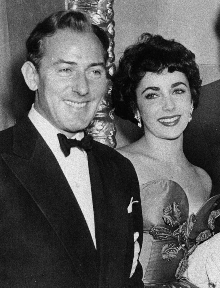 This 1951 file photo shows actress Elizabeth Taylor with actor Michael Wilding.  (AP Photo/File)