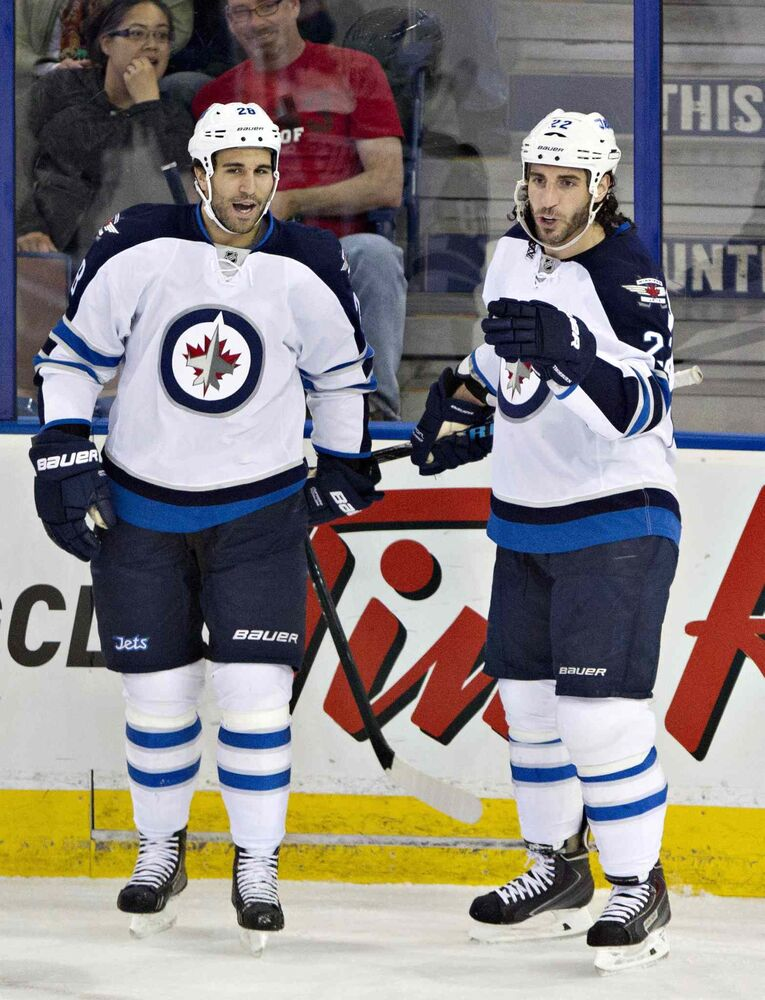 Blake Wheeler (left) and Chris Thorburn celebrate Thorburn's goal in the first period. (Jason Franson / The Canadian Press)