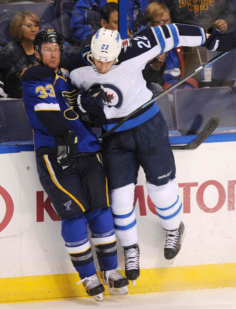 St. Louis Blues' Jordan Leopold collides along the boards Winnipeg Jets' Chris Thorburn during the second period. (Bill Boyce / the associated press)