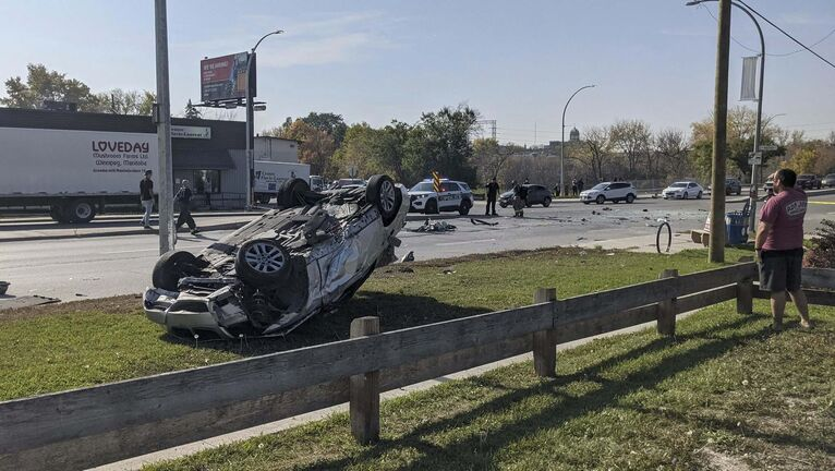 The vehicle fleeing police lost control and mounted the median and rolled, striking an oncoming vehicle. (Graem Poole photo)</p>