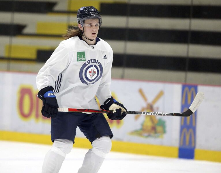 Jets content to let young defenceman mature in minors - Winnipeg Free Press