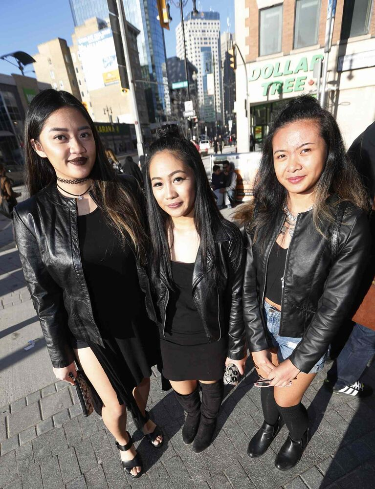Rihanna fans Camille (from left), Camille and AJ pose for a photo before heading into the show. (JOHN WOODS / WINNIPEG FREE PRESS)