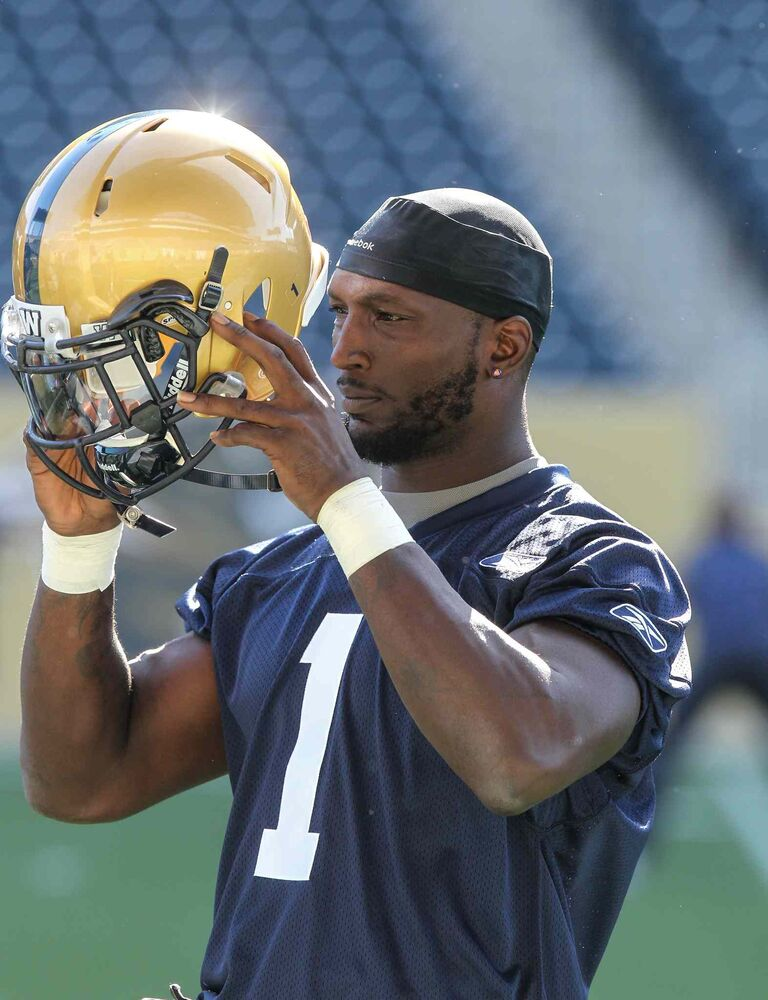 Ejiro Kuale dons his helmet during the first official day of the Winnipeg Blue Bombers training camp at Investors Group Field Sunday morning.  (MIKE DEAL / WINNIPEG FREE PRESS)