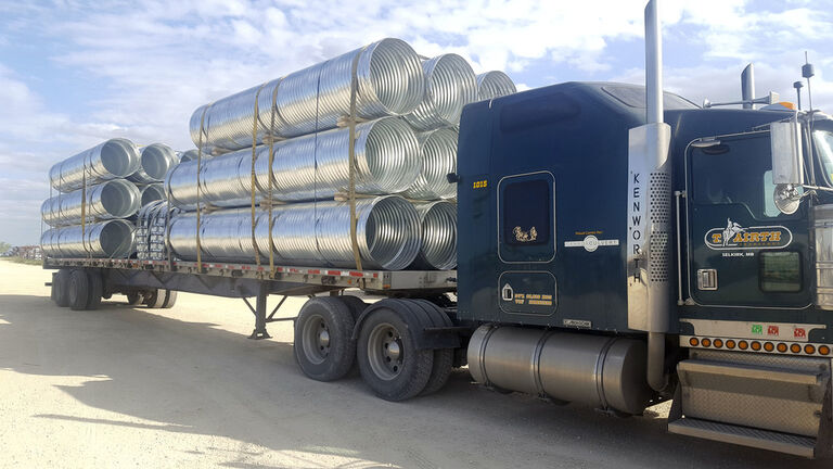 Culverts to be used for repairing the Hudson Bay Rail line are loaded on a flat deck trailer at Armtec-Canada Culvert plant in Winnipeg.