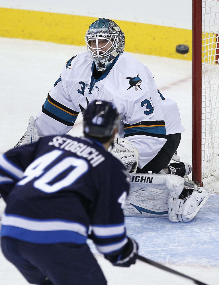 Winnipeg Jets' Devin Setoguchi (40) looks for the rebound off San Jose Sharks' goaltender Antti Niemi (31) during the first period.