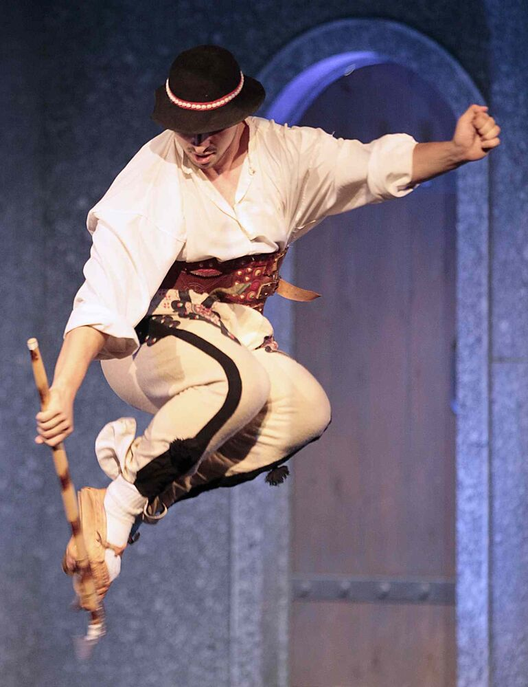 A performer gets some air at the Warsaw-Poland pavilion. ( John Woods / Winnipeg Free Press)