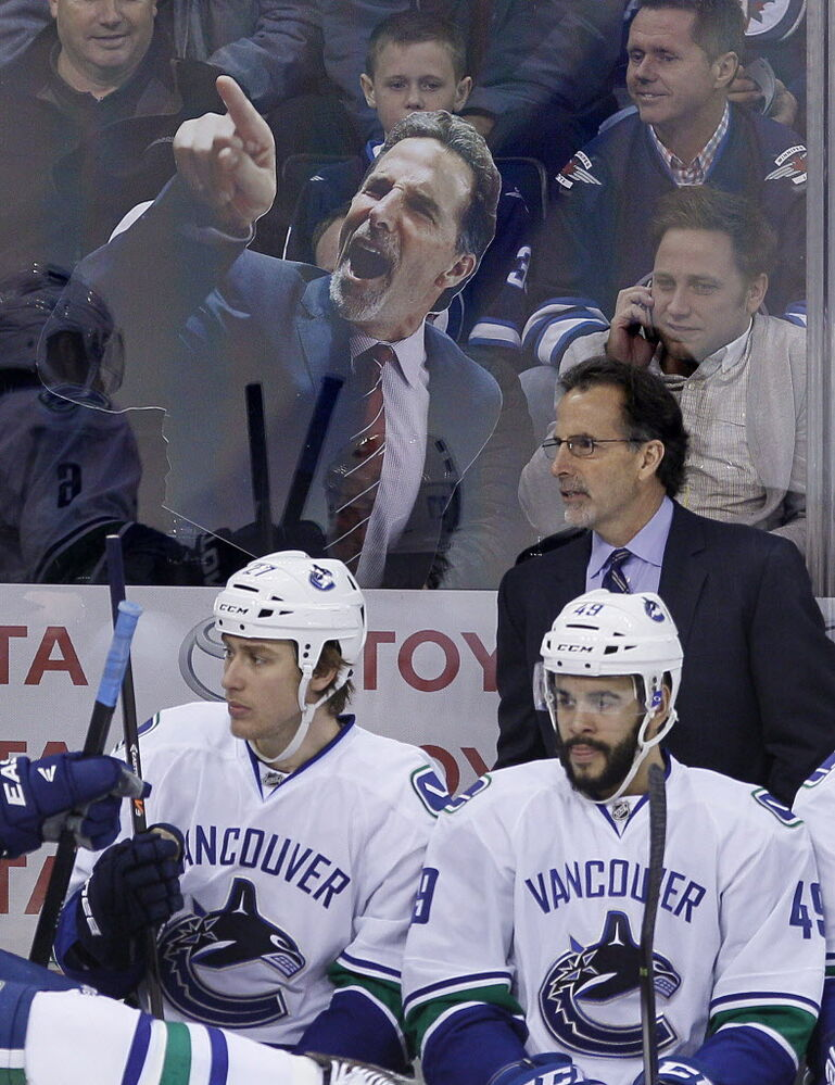 Winnipeg Jets fans taunt Vancouver Canucks head coach John Tortorella during first period NHL action in Winnipeg on Wednesday, March 12, 2014.