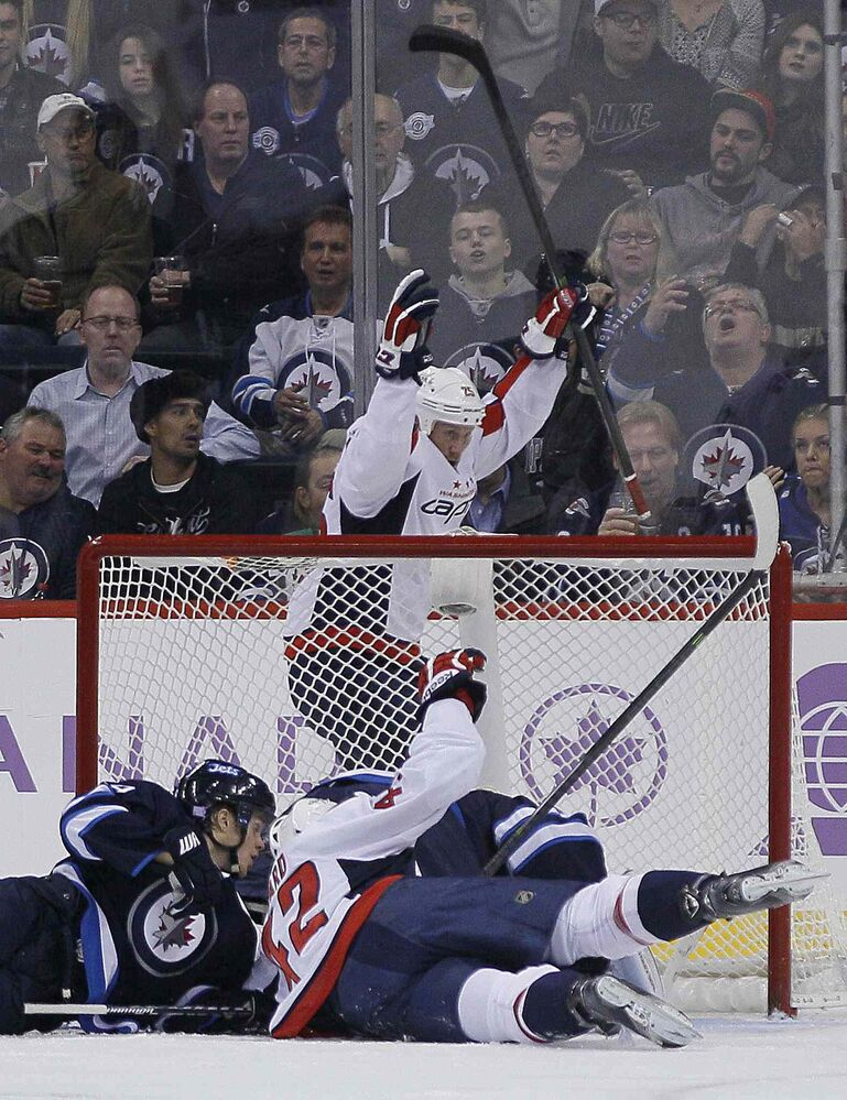 Washington Capitals' Jason Chimera (benhind net) celebrates Mikhail Grabovski's goal against the Winnipeg Jets during second-period NHL action.